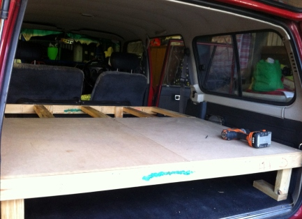 Bed frame assembly - note the storage space underneath (where clothes, gas cooker and other supplies were kept.